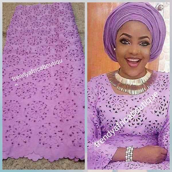 Beautiful Lilac Quality Swiss Voile lace fabric. Laser cut, soft texture and decorated with Crystal stones/pearls. Nigerian African french lace fabric.