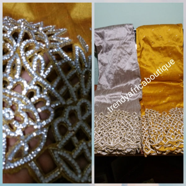 Clearance: Gold VIP handcut border George wrapper with crystal stones. Delta/Igbo women George wrapper with matching white blouse. Quality cut and stoned work. 5 full yards gold George wrapper not cut with 1.8yds white contract blouse