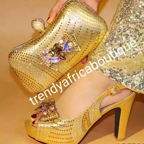 "Size 39 Gold high heel Italian matching platform shoe and hand clutch. Embellish with crystal stones Italian made shoe and bag. Sold as a set.  4"" high heel shoe run big in size."