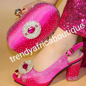 Clearance: only Size 39 and 40 fuschia pink Italian style matching platform shoe and hand clutch. Embellish with Quality  crystal stones on shoe and clutch. Italian made shoe and bag. Sold as a set. Shoe run big in size.heel is 3.5""