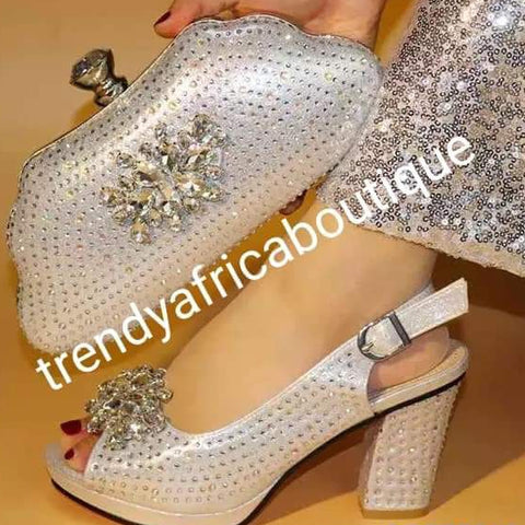 Available in Size 39, & 42 Silver Italian style matching platform shoe and hand clutch. Embellish with Quality crystal stones on shoe and clutch. Italian made shoe and bag. Sold as a set. Note shoe run big in size. Heel is 3.5""