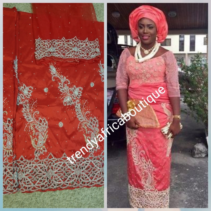 New arrival:Red VIP Celebrant Nigerian women George wrapper. Niger/Igbo/delta traditional wedding George hand stoned with dazzling crystal stones to perfection. for special occasion. 2.5yds + 2.5yds + 1.8yds net blouse. Beautiful handcut work