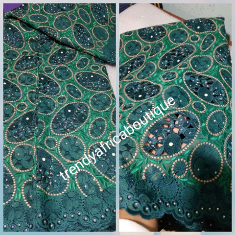 Exclusive swiss lace fabric in classic green. Nigerian traditional celebrant Swiss lace embroidered, beaded and stoned, handcut soft beautiful design. Sold per 5yds