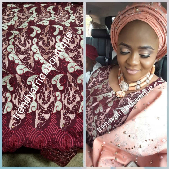 Maroon Swiss lace Fabric. Quality embroidery, all over crystal stones. Sold per 5 yards, peice is for 5yds. Nigerian celebrants Swiss lace at a discount price