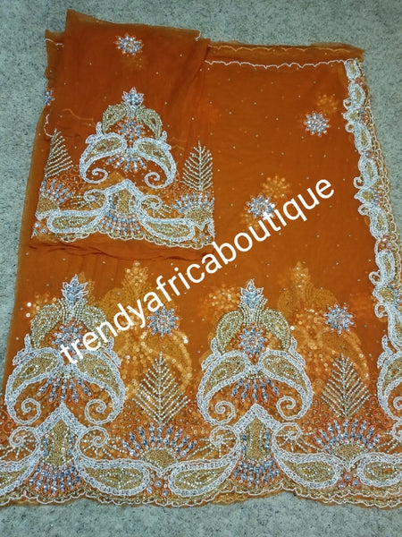 New arrival Gorgeous Igbo Traditional Bridal outfit- quality  net George wrapper and matching net for blouse. embellished with dazzling Crystal stones all over. 2 wrapper + 1.8yds net for blouse. Sweet orange net Ideal for Celebrant outfit