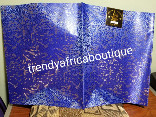 Nigerian royalblue/silver design Sago Gele head wrap. 2-1 pack gele. Easy to tie. 2 yds long by 19 inches wide. Classic African/Nigerian fabric for making gele (headtie) Sold per set. Price is for one set