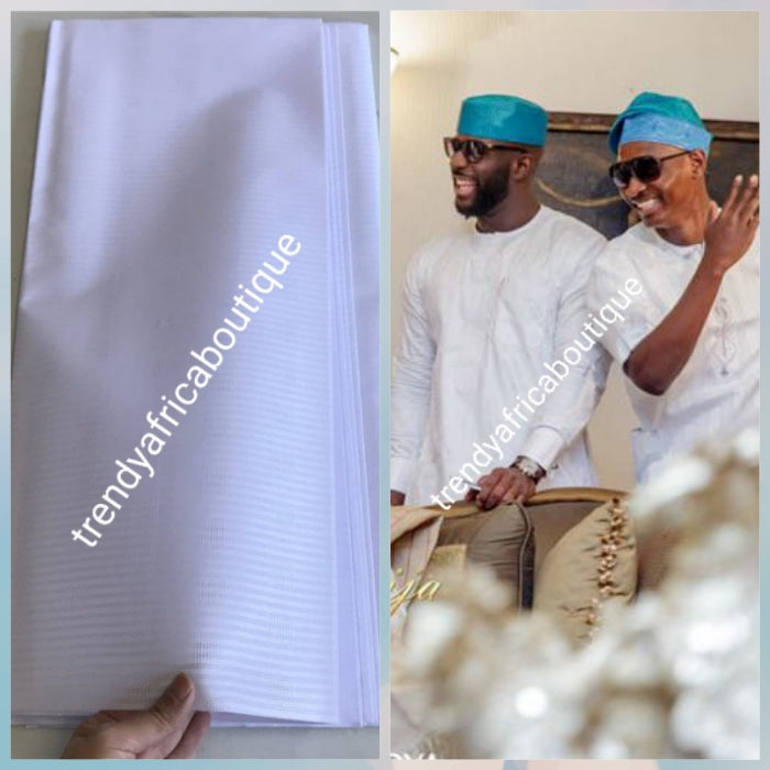 On Sale: Top quality pure white atiku swiss voile lace fabric for Nigerian Men native outfit. Soft quality fabric. Can be use for agbada/3pc outfit for men. Sold per 5yds. Price is for 5yds