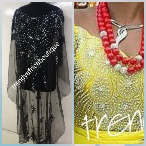 Black Heavily-beaded/crystal stones net George for making blouses. Popularly use by Igbo/Delta/edo women for big Occasions. Comes in 1.8yds lenght already design for your beautiful blouse