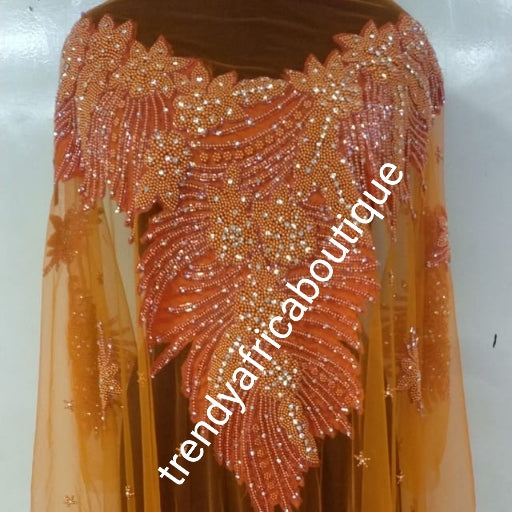 Orange Heavily-beaded/crystal stones net George for making blouses. Popularly use by Igbo/Delta/edo women for big Occasions. Comes in 1.8yds lenght already design for your beautiful blouse