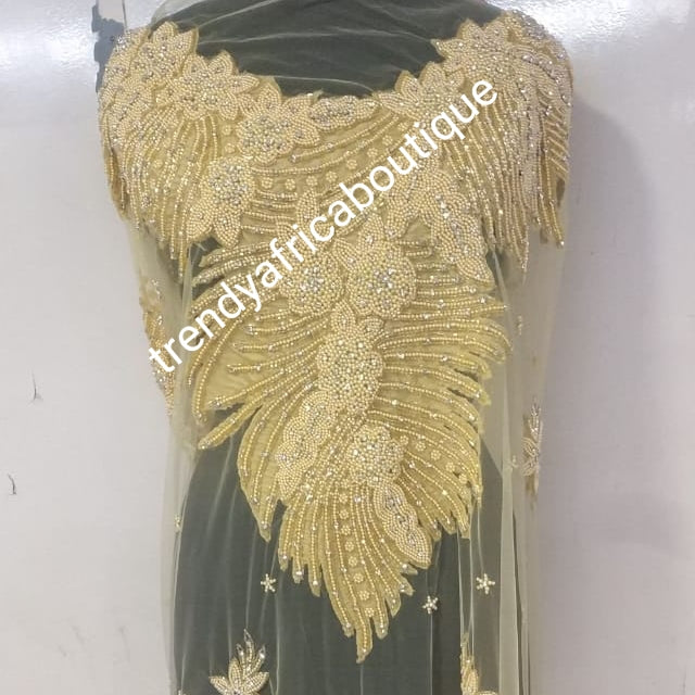 Champagn/gold Heavily-beaded/crystal stones net George for making blouses. Popularly use by Igbo/Delta/edo women for big Occasions. Comes in 1.8yds lenght already design for your beautiful blouse