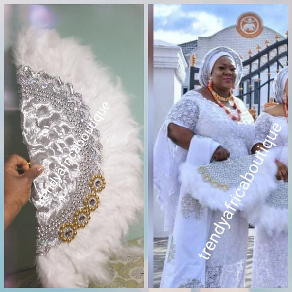 "Back in stock. Pure White/silver Feather hand fan. Large moon shape hand fan Nigerian  Bridal-accessories front and back middle design with beads and flower petal. Limited quantity. 25"" long + 14"" wide. Small handle to hold your fan. Very class"