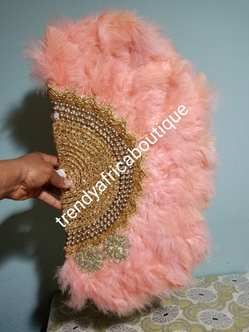 "Peach  Feather hand fan. Medium size moon shape hand fan Nigerian  Bridal-accessories front and back  design with gold beads and flower petal. Limited quantity. 19"" long + 14"" wide. Small handle to hold your fan. Very class"