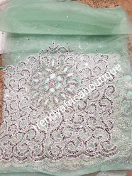 Mint Green/silver crystal hand stoned VIP celebrant George wrapper for Nigerian Ceremonies such as weddings. Igbo/Niger/ Delta/ wedding George. Set of Net + taffeta+ matching net for blouse. Breath taking crystal work!!! Model is wearing same design