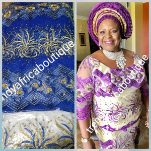 Sale: Exclusive Design African Net French Lace fabric. Royal blue lace embriodered with gold, Bead and Crystal stones perfect for that special occasion. Sold per 5yds and price is for 5yds