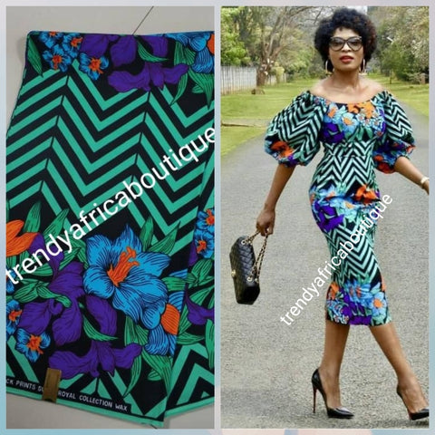 Green with flower border 100% veritable cotton Ankara wax print fabric. Sold per 6yds. Price is for 6yds. Soft texture. Excellent quality for making fabulous African outfit