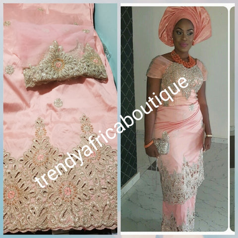 Original quality sweet peach with gold embriodery and beaded silk George wrapper. Nigerian traditional wedding George, Quality Indian-George. 5yds wrapper + 1.8yds net matching blouse. Aso-ebi available. Contact us for detail.