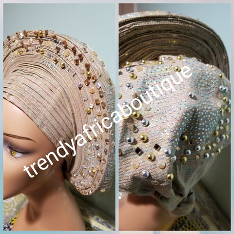 Quality champagne gold Auto-gele made with quality Aso-oke. Beaded and stoned work front and back to perfection.  One size fit, easy to adjust for fit and knot at the back to secure your gele. This is true original auto gele