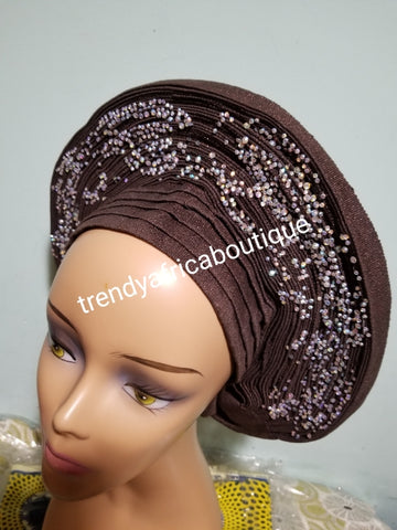 Quality chocolate brown Auto-gele made with quality Aso-oke. Beaded and stoned work front and back to perfection.  One size fit, easy to adjust for fit and knot at the back to secure your gele. This is true original auto gele