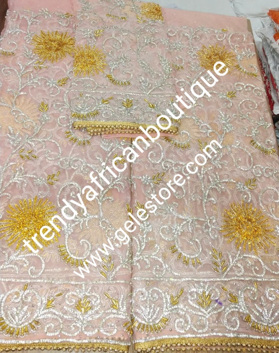 Sweet Peach VIP Madam Net George wrapper for Nigerian bridal/Celebrant wrapper. Heavily embellished with silver and gold crystal on 2.5yds+ 2.5yds + 1.8yds matching net for blouse . Sold as a set. Special occasion George