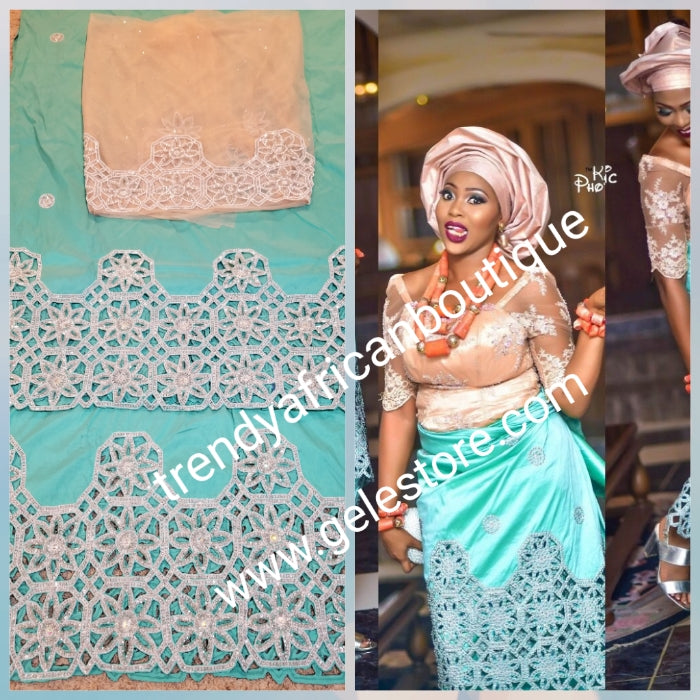 Ready to ship:Mint green/peach blouse Quality taffeta Silk George wrapper embellished with dazzling Crystals and beaded to perfection for IIgbo/Niger/Delta women Red carpet events. Sold as  2 wrapper + 1.8yds Net for blouse. You will love the quality!