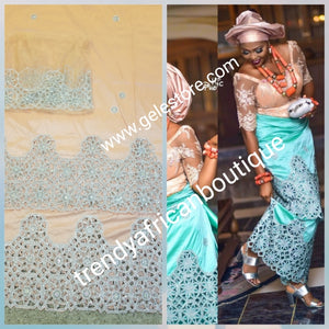 Ready to ship: Peach/peach blouse Quality taffeta Silk George wrapper embellished with dazzling Crystals and beaded to perfection for IIgbo/Niger/Delta women Red carpet events. Sold as 2 wrapper + 1.8yds Net for blouse. You will love the quality!