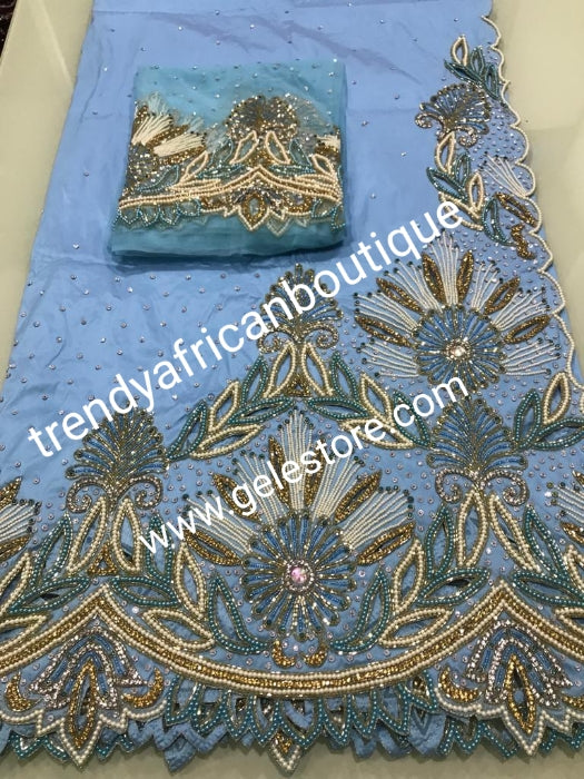 Sale: sky blue first Lady/VIP hand beaded and stoned Nigerian traditional Celebrant George with matching blouse. Niger/Delta/Igbo women Georges. Exclusive Side beaded design wrapper, Sold as a set of 2 wrapper +1.8yds matching net for blouse