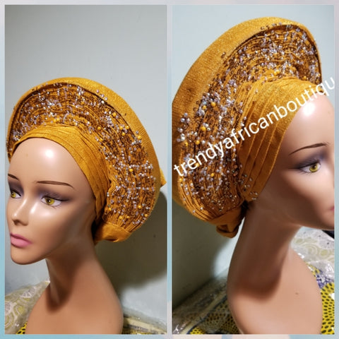 Clearance: Beaded and stoned Gold Auto-gele made with quality Aso-oke. Beaded and stoned work front and back to perfection.  One size fit, easy to adjust  and knot at the back to secure your gele. This is true original auto gele