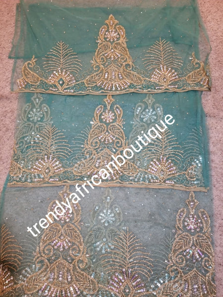 Ready to Ship: Gorgeous Igbo Traditional Bridal outfit- in mint green net George wrapper and matching net for blouse. embellished with dazzling Crystal stones all over. 2 wrapper + 1.8yds net for blouse. Classic green net Ideal for making Celebrant outfit