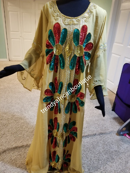 Ready to ship: Beige dubai kaftan  dress. free flowing embellished with Multi color sequence front and back dress to perfection. Availablein size, M,L,XL. Chiffon includes headtie. 60' long