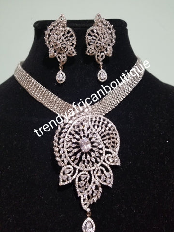 "2pcs 22k quality  white/silver electroplating in choker set. Sold as a set. Pendant is mounted with crystal CZ diamond stones. Top quality/hypo allergenic plating. Bold pendant with 17"" long necklace"
