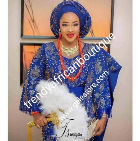 4pcs Bead-dazzled with Swarovski stone work. Lateast design Celebrant Aso-oke set. Custom-made. Made-to-order only. Nigerian traditional wedding outfit. Allow 6-8 weeks for processing time. 4ps wrapper, blouse, gele/ipela all beaddazzled from mother land