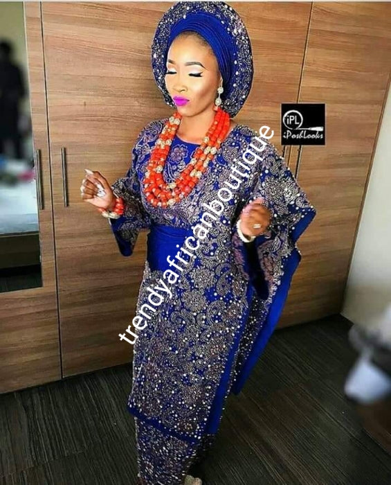 Latest bead-dazzled Aso-oke set for Nigerian Traditional Weddings/ceremonies. All hand made stoned and beaded classy blouse/wrapper + Gele/ipele.  Produce-per-order only. Custom-made design in your color of choice.  Allow 6-8 weeks for order process.