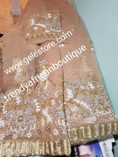 Ready to ship. Classic champagne gold net George. perfect stone work for traditional Bridal outfit. Quality beaded and dazzling crystal stoned on a  net George wrapper. 2.5yds + 2.5yds + 2yds.fabric. Sold as a set, price is for a set.