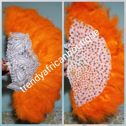 "Clearance Orange Feather hand fan. Medium front and back design moon shape hand fan Nigerian  Bridal-accessories front and back  design with gold beads and flower petal. Limited quantity. 19"" long + 14"" wide. Small handle to hold your fan. Very classy"