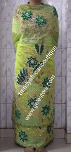 Ready to ship. Exclusive design sweet Lemon green Madam/celebrant Nigerian George wrapper.  2.5yds + 2.5yds + 1.8yds matching net  for blouse. Tradtional Igbo/Delta Bridal outfit. Lemon Taffeta with Olive green velvet accent
