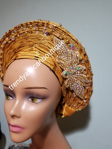 Beaded and stoned Gold Auto-gele made with quality Aso-oke. Beaded and stoned work front and back to perfection.  One size fit, easy to adjust  and knot at the back to secure your gele. This is true original auto gele