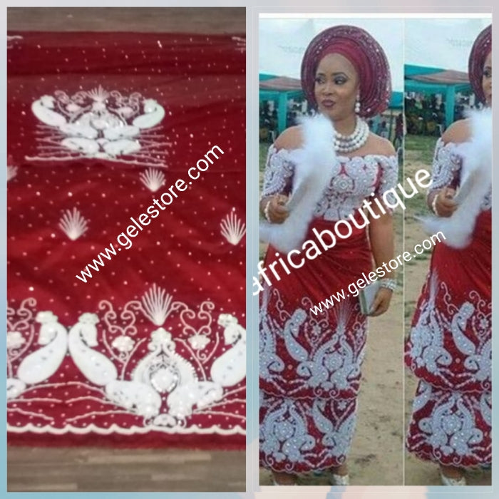 New arrival Superior Quality VIP maroon taffeta. Nigerian Traditional wedding George Wrapper/matching net blouse. Sold 2.5yd + 2.5yds wrapper and 1.8yds blouse fabric for making blouse. All over Finest Quality white beads and Crystal stone hand work