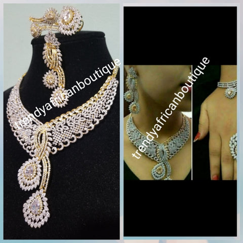 Back in stock- Special price: New arrival Celebrants 4pcs matching set of 22k Gold Electroplated with CZ silver  stones setting. Quality piece of accessories, hypoallergenic. Necklace, earrings, ring and bangle set.
