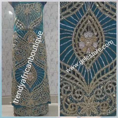 Exclusive design Quality VIP hand beaded and Crystal stoned George wrapper.  Produce-per-order George in your choice of color. Hand cut stone work. 5yds + 1.8 yds matching net blouse. Allow 3 weeks to produce and ship to you. Red carpet/1st lady wrapper