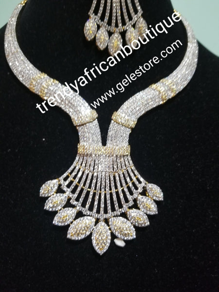 Sale: New arrival Celebrants 4pcs Bridal set: 22k  Electroplated with dazzling white/gold CZ stones setting. Bridal piece of accessories, hypoallergenic. Necklace, earrings, ring Is open for finger adjustment and a matching bangle set.