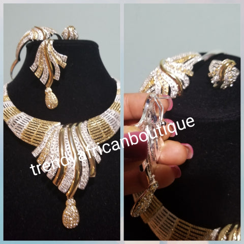 Sale sale: Beautiful Dubai costume jewelry set in 18k two tone gold plating. High quality hypoallergenic jewelry set. 4pcs set. Sold per set. Embellished with crystal stones.