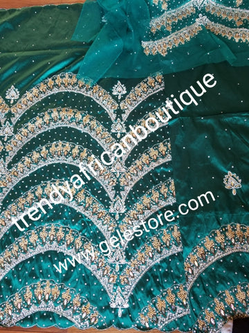 Ready to ship:  Exclusive design Teal Green VIP hand beaded and stoned Nigerian traditional Celebrant taffeta Silk George wrapper with matching net for blouse. Niger/Delta/Igbo women wrappers Sold as set of 2 wrapper +1.8yds blouse. Quality Guaranteed