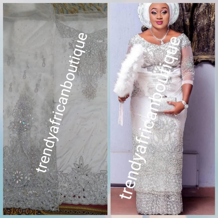 Combo sale: White crystal Net George wrapper 2.5yds  Net+ 2.5yds taffeta silk+ 1.8yd net for blouse+ white aso-oke gele all embellished with dazzling silver crystal stones. Nigerian Bridal George for that special occasion. Quality