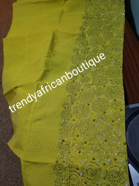 "New arrival beautiful sweet yellow  Bedazzled Aso-oke Gele headtie.  4 wide for making  bigger gele. classic Latest design of Nigerian Traditional aso-oke. Original aso-oke + Stone work. Hand weave in Nigeria for best quality 72"" long by 26"" wide"