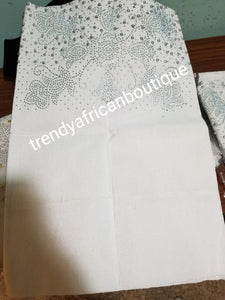 "New arrival white Bedazzled Aso-oke use for Gele (headtie) 4 wide for making  bigger gele. Latest design of Nigerian Traditional aso-oke. Original aso-oke + all silver beads and Stoned work. Hand weave in Nigeria for best quality 72"" long by 26"" wide"