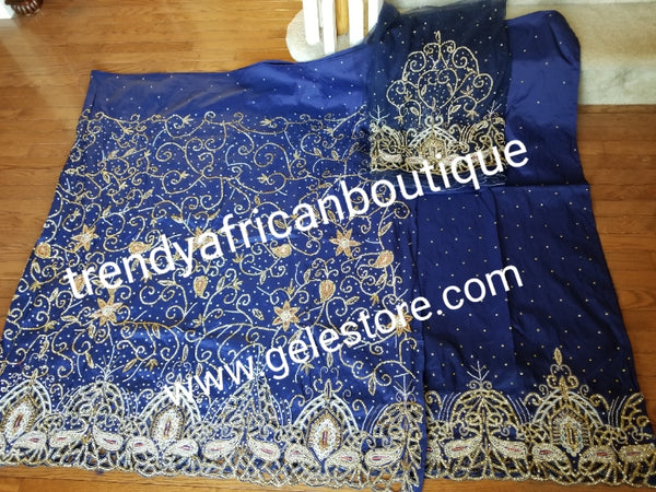 New arrival Navy Blue VIP Silk George wrapper. 2.5yds top wrapper heavily beaded and crystal stones + 2.5yds bottom wrapper stone border + 1.8yds net blouse. Use For  Nigerian weddings/Ceremonies.
