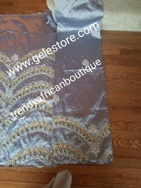 Ready to ship:  Exclusive design VIP hand beaded and stoned Nigerian traditional Celebrant in quality taffeta Silk George wrapper with matching blouse. Niger/Delta/Igbo women Georges. Sold as set of 2 wrapper +1.8yds blouse. Available in 4 colors.