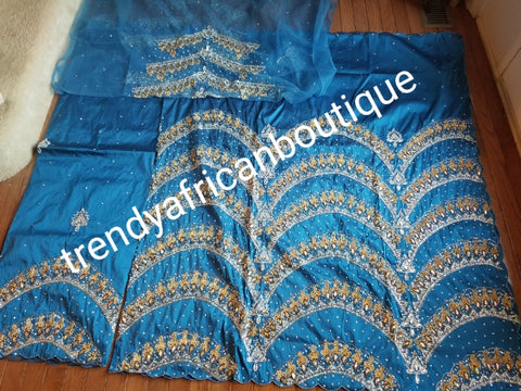 Ready to ship:  Exclusive design Turqouis blue VIP hand beaded and stoned Nigerian traditional Celebrant in quality taffeta Silk George wrapper with matching blouse. Niger/Delta/Igbo women Georges. Sold as set of 2 wrapper +1.8yds blouse.