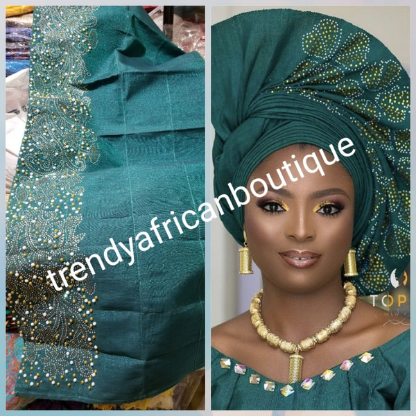 "Beautiful teal Green aso-oke. Nigerian traditional Aso-oke for making head wrap. Hand woven and beaddazzled with crystal stones and beads at the border for perfect headwrap finish. Gele only. Extra wide gele for bigger head wrap. 72"" long × 26"" wide"
