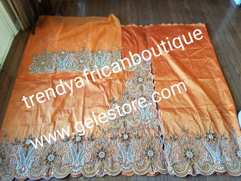 Sweet Orange VIP Hand  beaded and crystal Stoned Silk George wrapper, champagne net for blouse.  Nigerian, Igbo/Delta traditional wedding out fit. Sold as full 2.5yds with side border design + 2.5yds + 1.8yds matching net for blouse. Quality taffeta silk!